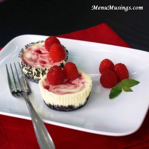 diy raspberry swirl cheesecake minis 28 Wonderful DIY Mini  Raspberry Swirl Cheesecakes