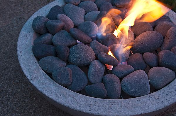 Fill the concrete fire pit with stones