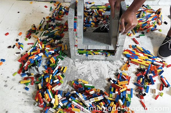 Removing the Lego bricks from the Concrete nesting tables