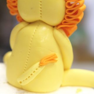 Cuddly Royalty: How to Make a Cute Lion Cake Topper
