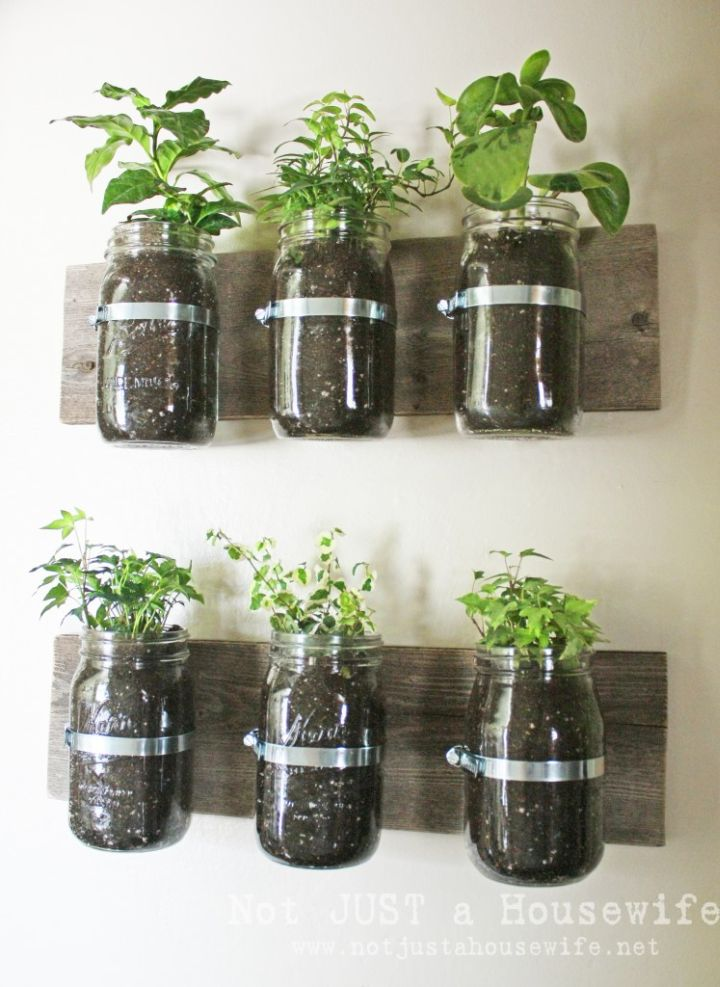 Mason jar planter board 6 Cool Ways to Make Use of Mason Jars