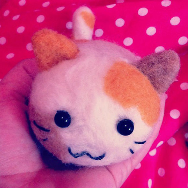 Round felted kawaii cat