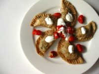 Spinch and eggplant perogies with grape tomatoes and yogurt sauce 200x150 15 Awesome Recipes That Take Perogies to the Next Level