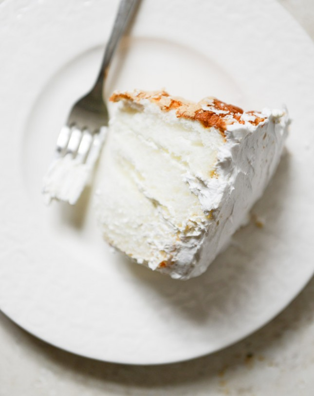 Angel food layer cake with coconut whipped cream and grapefruit syrup