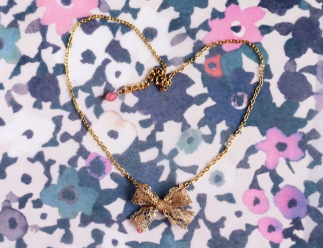Anthropologie-inspired gilded lace bow necklace
