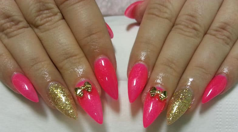 VIEW IN GALLERY Pink And Gold Stiletto Nails With A Bow