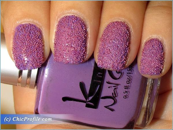 Purple caviar nails
