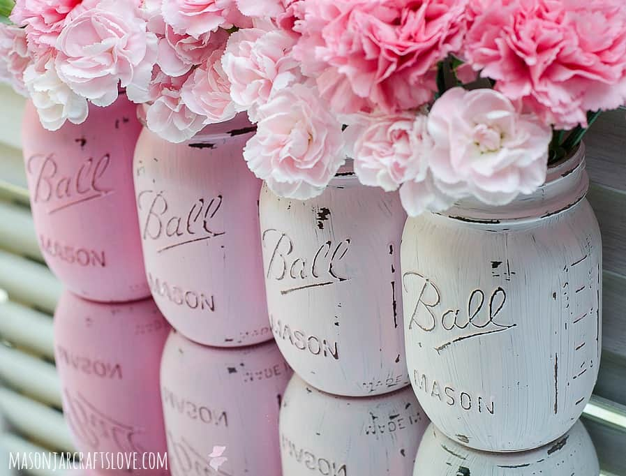Pale pink mason jars with pink flowers