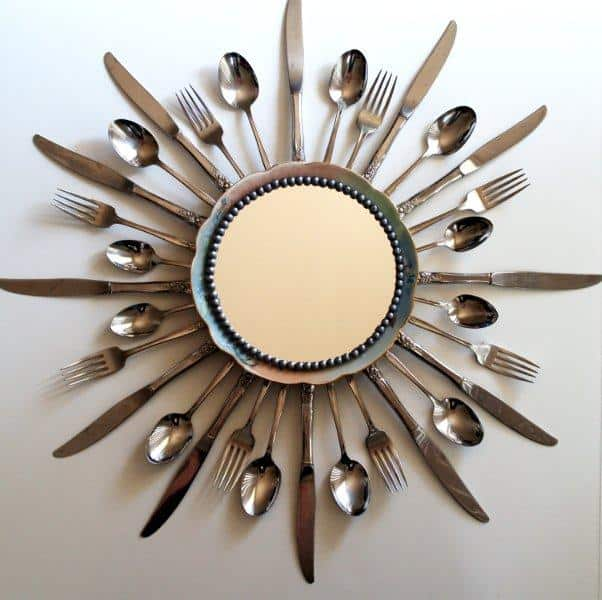 Bursting cutlery mirror frame