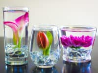 DIY submerged flowers 200x150 Beyond Spring: 15 Flower Arrangements That Will Inspire Your Own DIY Bouquets