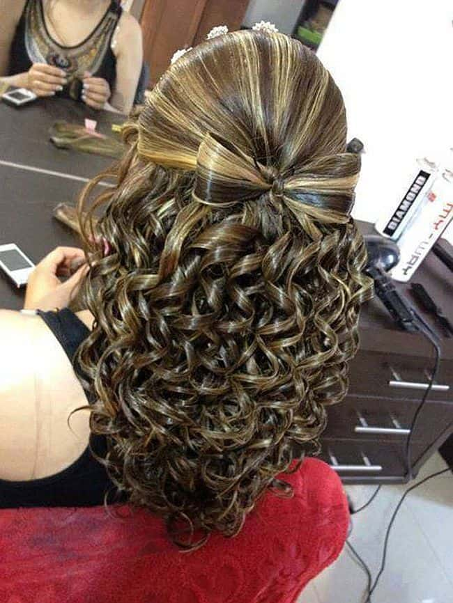 Fashionable smooth hair bow and tight ringlets