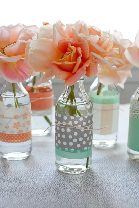 Glass bottles and scrapbooking paper
