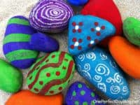 Polka dots spirals and wiggly lines 200x150 15 Beautiful Rock Painting Ideas
