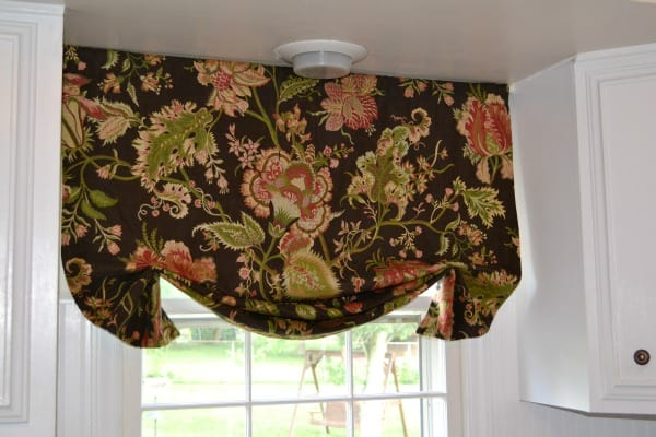 Draping, pleated floral fabric valance