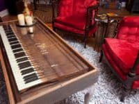 Glass covered piano key coffee table 200x150 12 Creative Ways to Repurpose Piano Parts