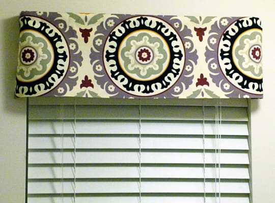 Intricately patterned no-sew window valance
