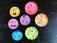 Mason jar monster lids 200x150 15 Brilliant Ways to Recycle Mason Jar Lids