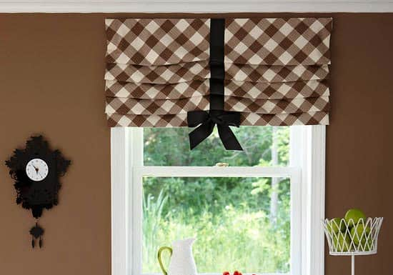 Pleated, layered window valance with a hanging bow