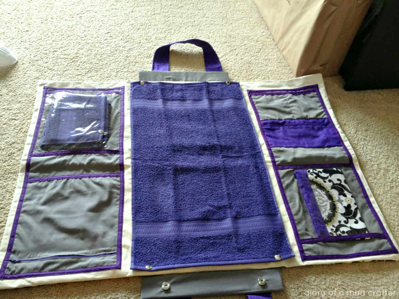 Unfolding diaper bag and changing station