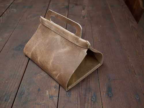 Unfolding upscale leather lunch bag with a handle