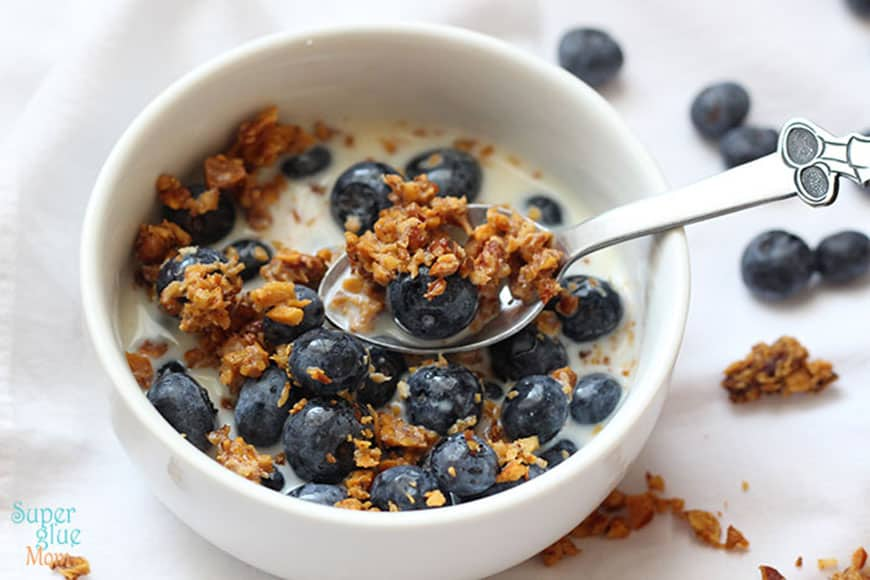 Vanilla nut granola with milk and blueberries