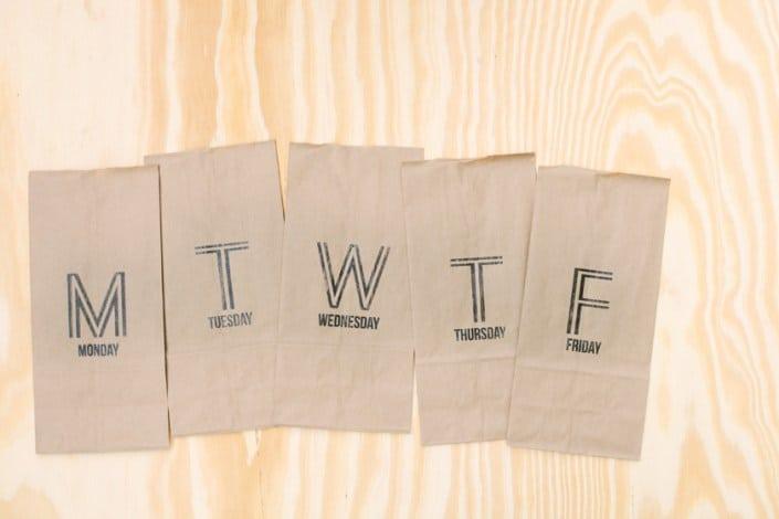 Weekday stamped paper bags