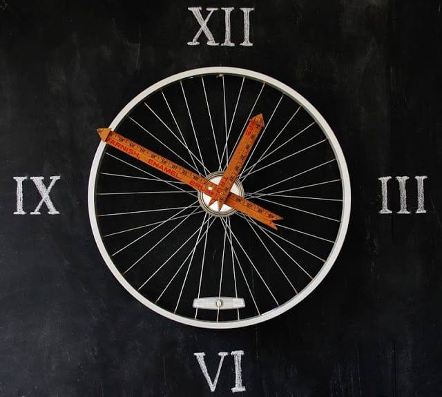 Yard stick and bicycle wheel clock