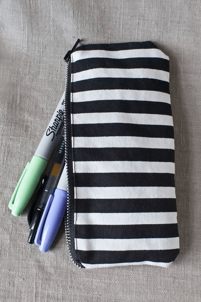 Zipping black and white stripe pouch