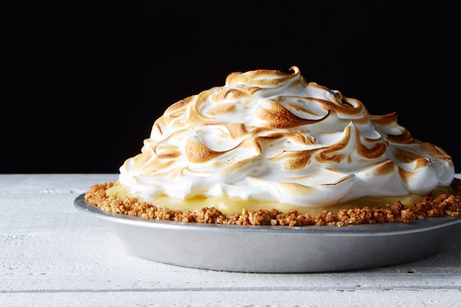 Passionfruit meringue pie with macadamia crust