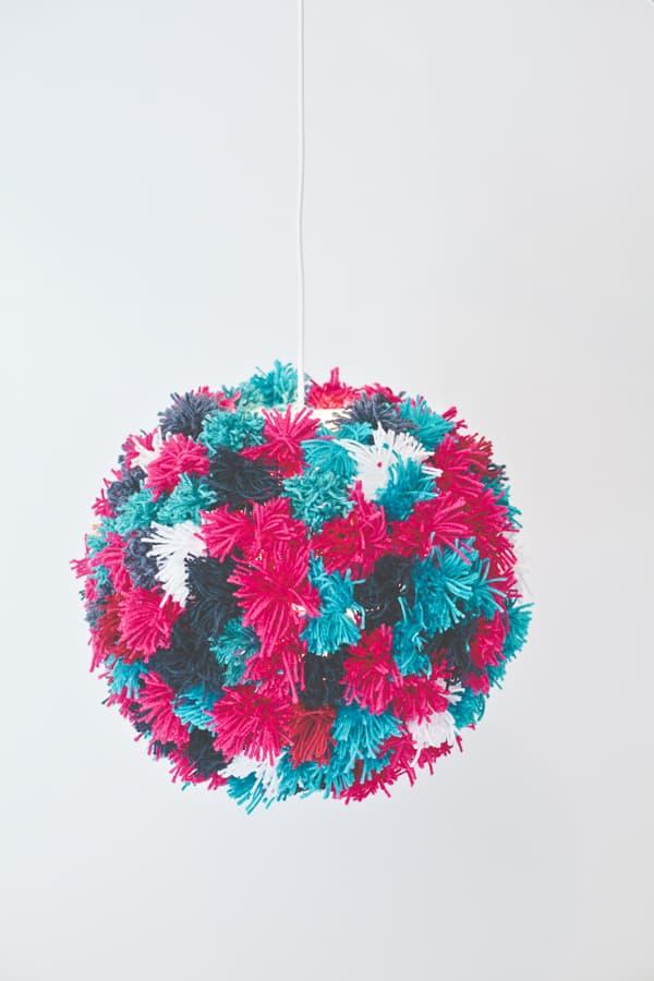Hanging pom pom pendant
