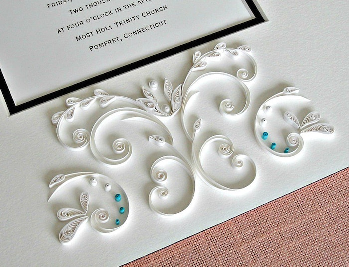 Quilled wedding invitation embellishment