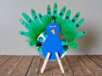 Recycled CD peacock 200x150 Colorful Treat: 14 Peacock Themed Crafts for Kids!