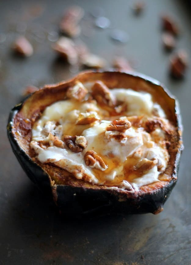 Breakfast baked acorn squash with greek yogurt, honey, and pecans