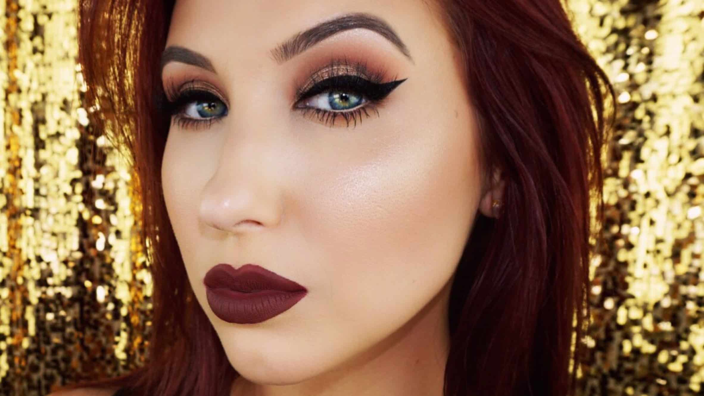 Dramatic cat eye and dark lips