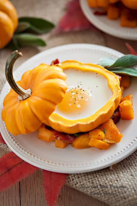Eggs in a mini pumpkin with roasted squash and bacon hash