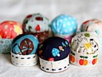 Tiny bottle cap pin cushions 200x150 13 Adorable DIY Pin Cushions