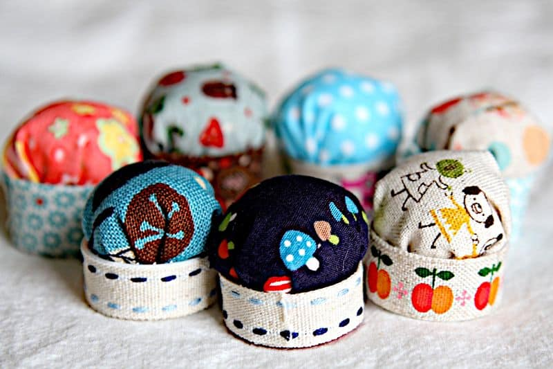 Tiny bottle cap pin cushions