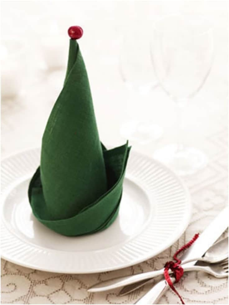 VIEW IN GALLERY Elf hat napkin - Fun Ways To Fold Your Napkins For Christmas Dinner