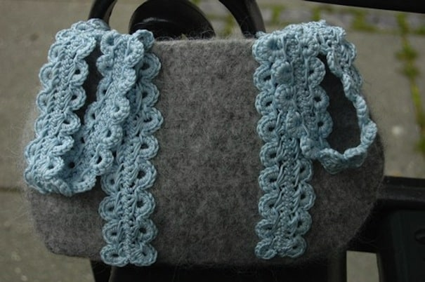 Felted bag with crocheted lace handles