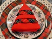 Red and plaid Christmas tree napkin 200x150 Fun Ways to Fold Your Napkins for Christmas Dinner