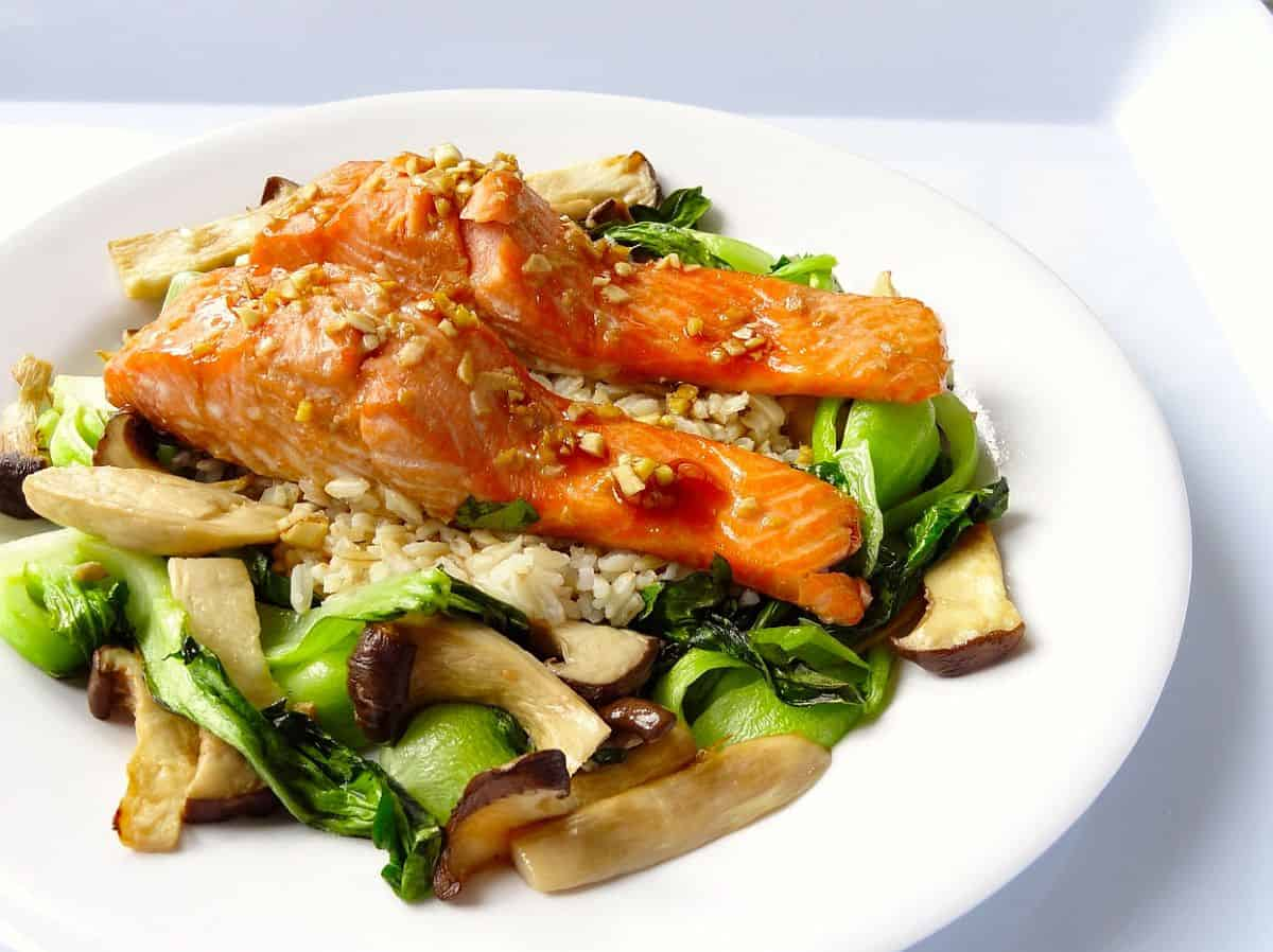 Cool salmon couscous salad with snap peas, orange, and mint