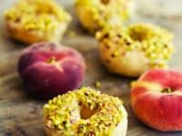 Peach glazed donuts with white chocolate and pistachios 200x150 Homemade Doughnut Recipes That will Make Your Drool