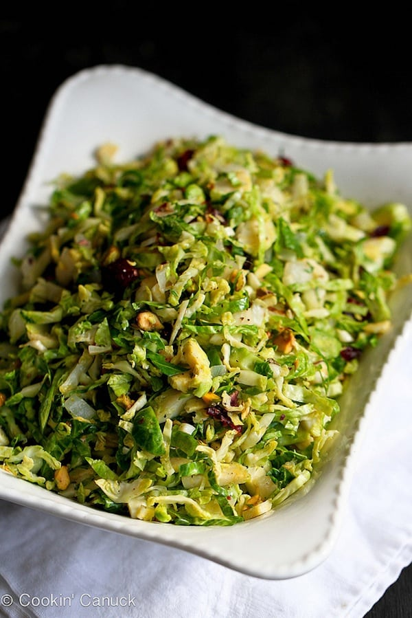 Shredded brussel sprouts recipe with pistachios, cranberries, and parmesan