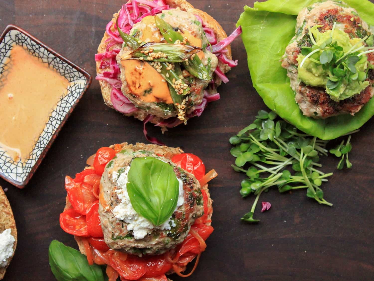 Juicy turkey burgers with sauteed tomatoes, basil, and ricotta
