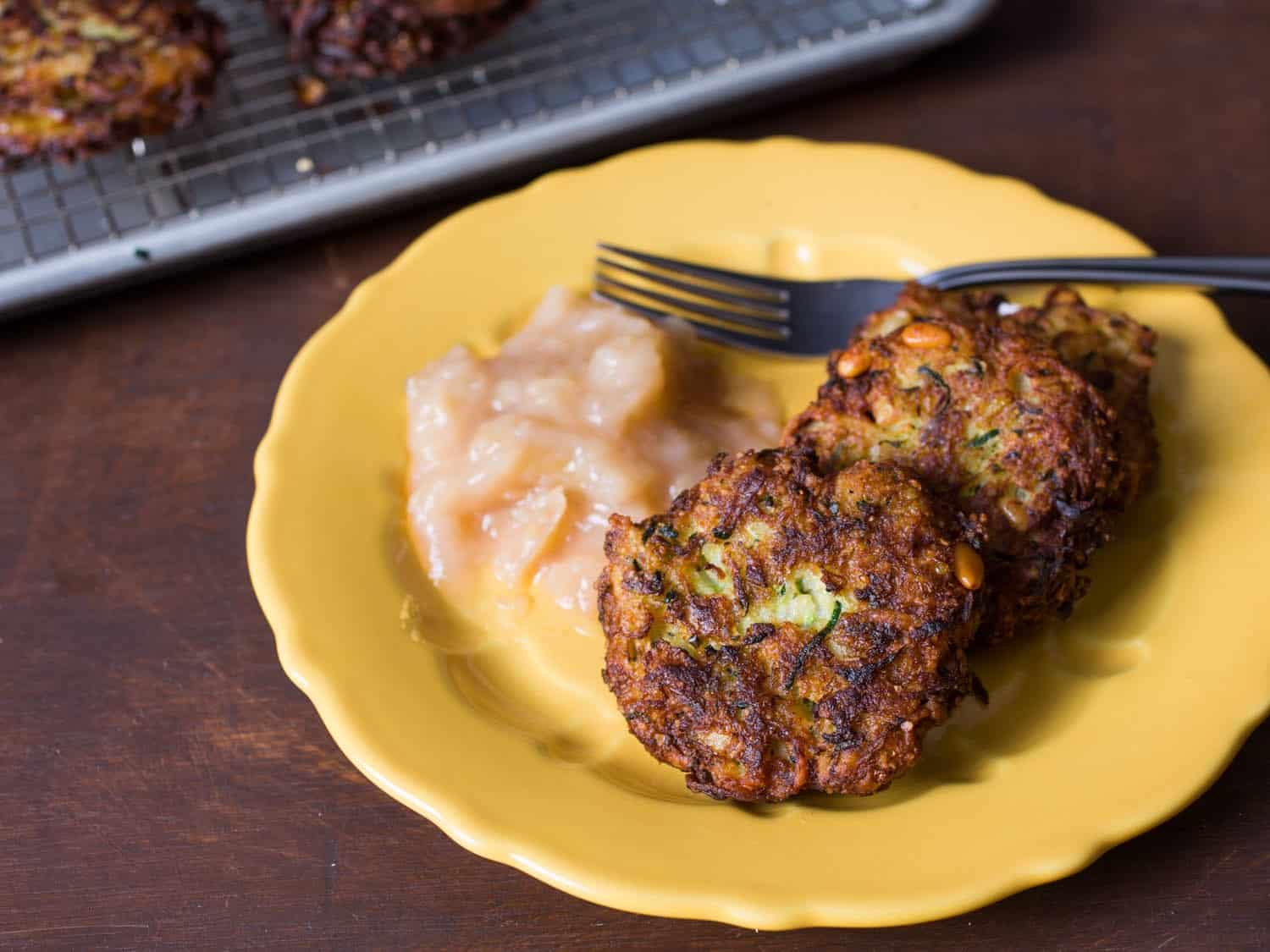 Zucchini latkes with parmesan, pine nuts, and basil recipes