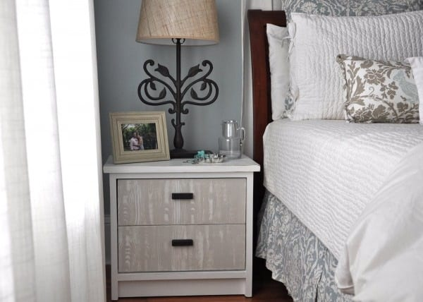 Faux wood finish bedside table
