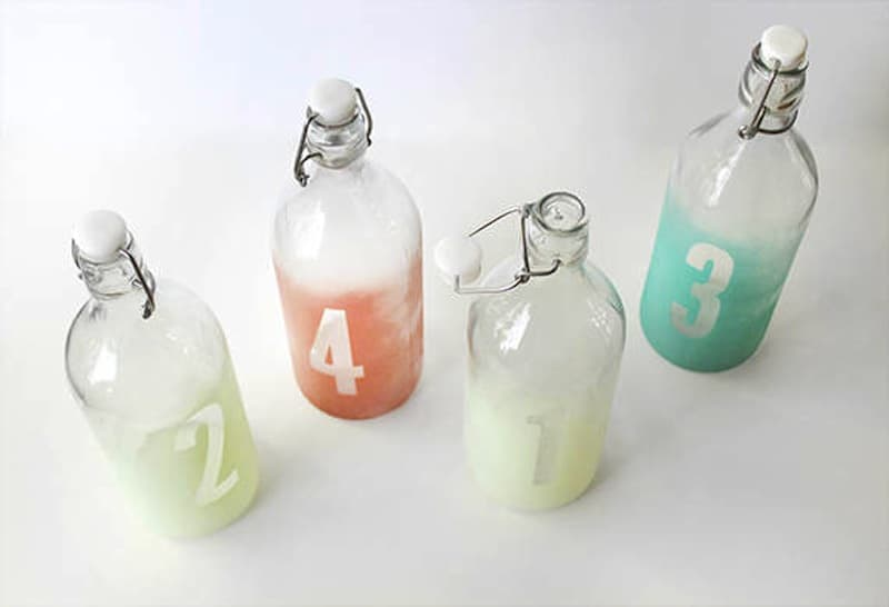 Stenciled glass bottle seat markers
