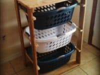 Reclaimed wood basket rack 200x150 Creative Ways to Repurpose Laundry Baskets