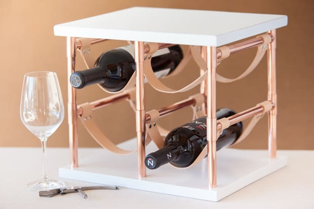 Copper and leather wine rack