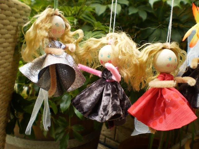 Fairies from scrap fabric, pipe cleaners, and wooden beads